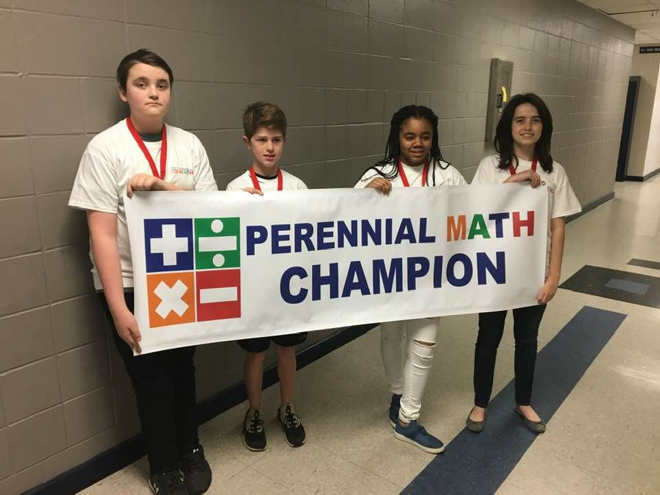 Students hold a banner that says Perennial Math